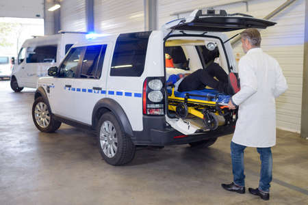 paramedics offloading patient from an ambulance Stock Photo