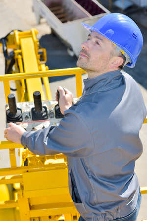 worker driving a crane Stock Photo