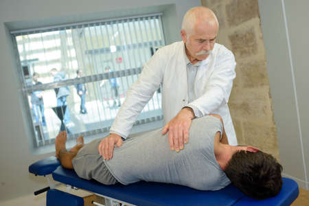 chiropractor examine the patients spine Stok Fotoğraf