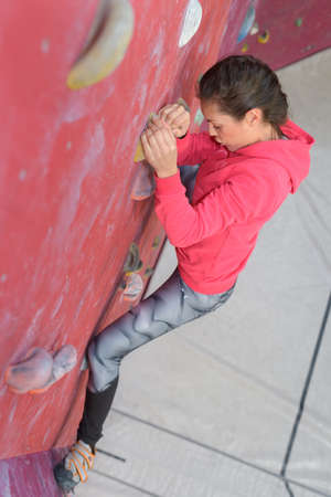 drilled: woman climbing the wall