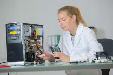 mother assembler solving the problem Stock Photo