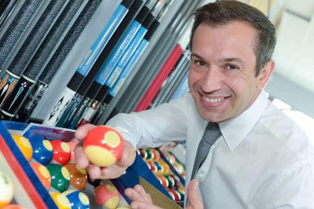 man showing pool balls Stock Photo