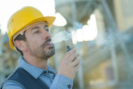 worker smoking electronic cigarette