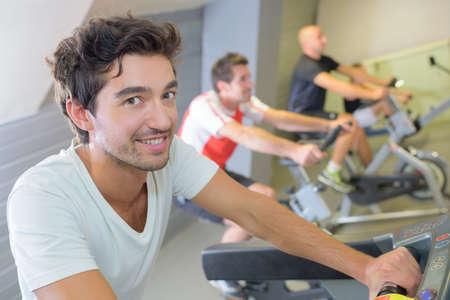 Men on fixed cycling machines Stock fotó - 86445364