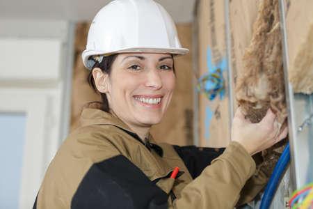female plasterer removing the material