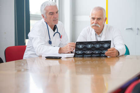 doctors examining the result Stock Photo