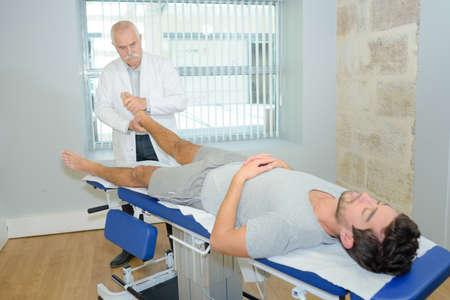 therapist massaging the foot Stock Photo