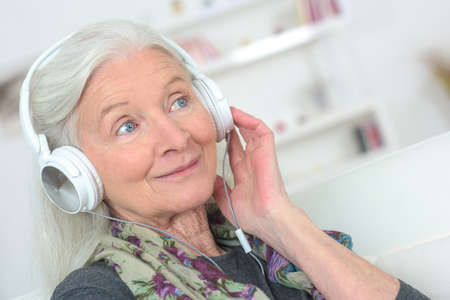 elderly woman wearing a headset