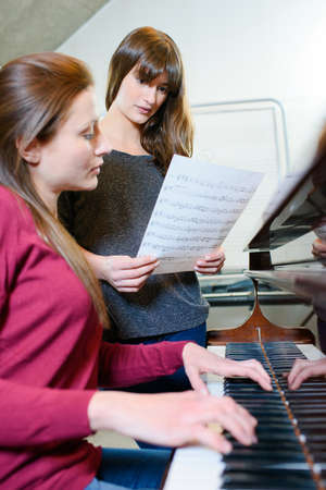 women and a piano Stock Photo