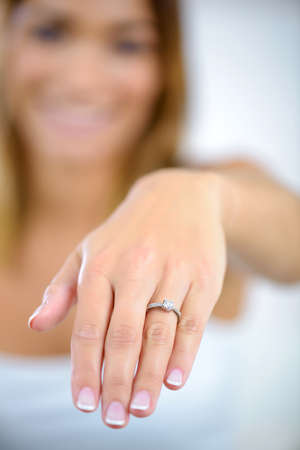 woman showing engagement ring