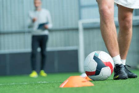 Closeup of man dribbling football