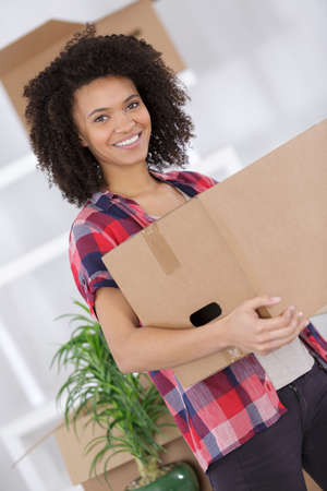 Young lady carrying cardboard box