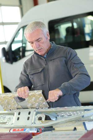 Man working with checkerplate