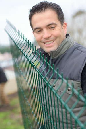 installing the fence Фото со стока
