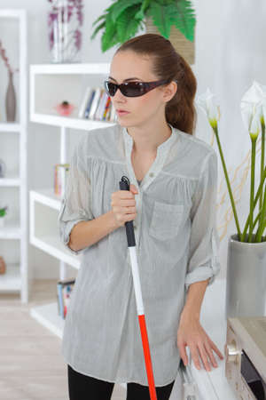 Woman with sight impediment in the home