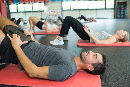 Exercise class doing a pelvic lift