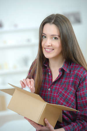 Portrait of girl holding open cardboard box Stock Photo