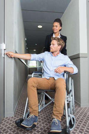 businessman in a wheelchair at hotel