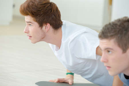 Young men in Cobra yoga position Stock Photo