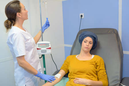 Young woman receiving chemotherapy treatment Stock Photo - 86844176