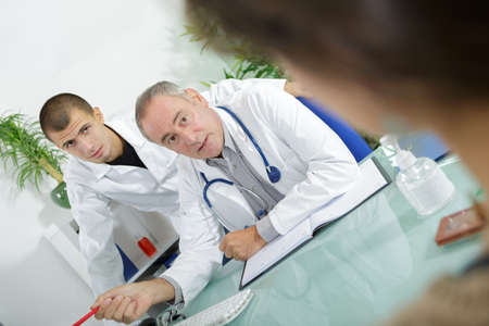 Male medical workers waiting for reply from patient
