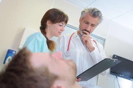 Medics looking at patients notes