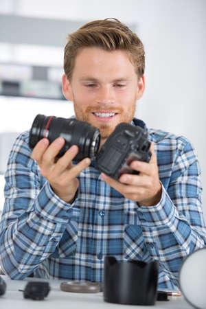 technician engineer assembling camera Stock Photo