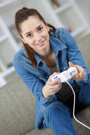gad: cheeful girl playing video games alone