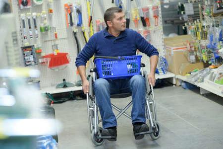 man in wheelchair shopping