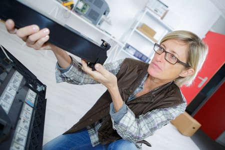 xerox: womanperforming toner change and printer maintenance