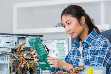 female technician checking mother board