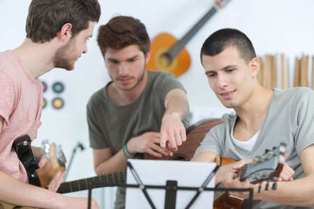 Young men in band rehearsal Stock Photo