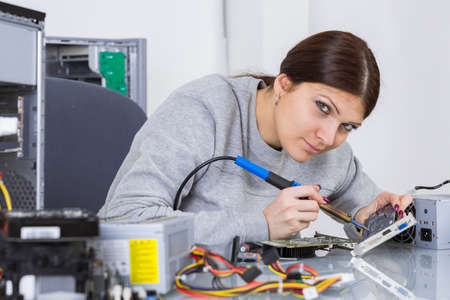 mending electronic parts Stock Photo
