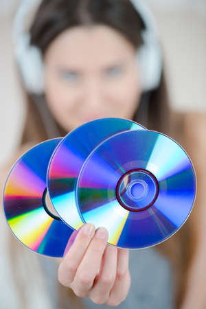 dvd rom: young woman holding dvd-rom or cds