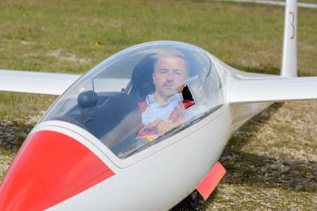 pilot inside glider on the runway ready for takeoff Stock Photo