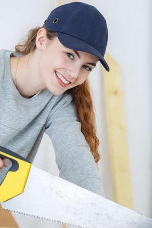 portrait of beautiful young female carpenter