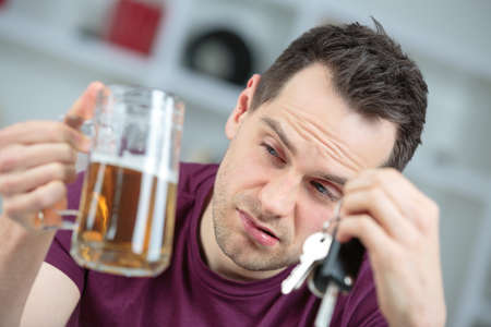 drunk man thinking of driving