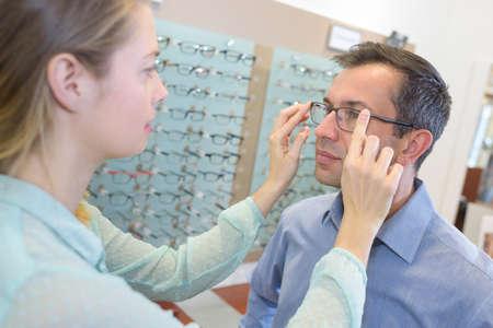 optician assisting a customer
