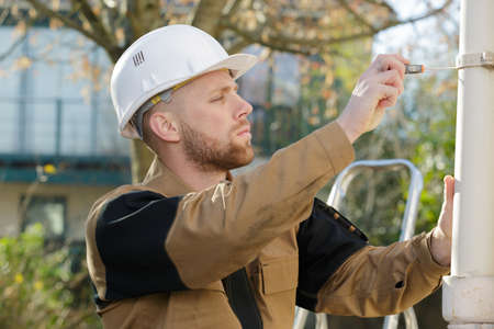 young builder working outdoors