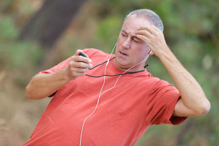 runner checking his heart rate pulse during workout