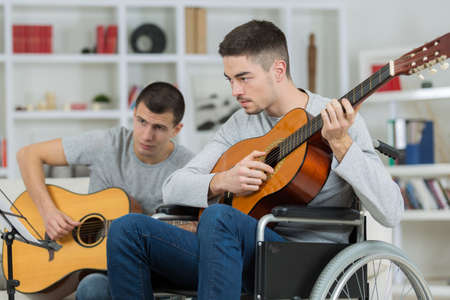 friends playing guitar