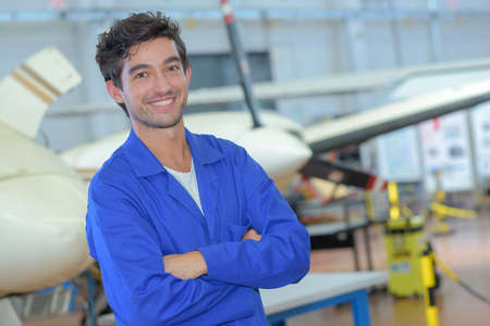 aircraft worker posing