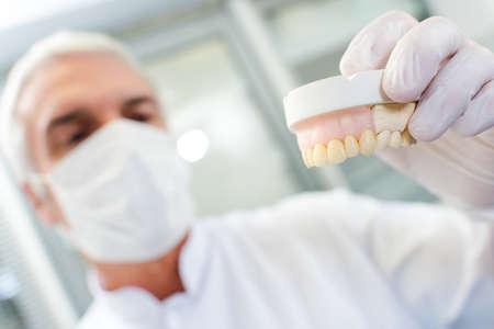 Dentist holding mould
