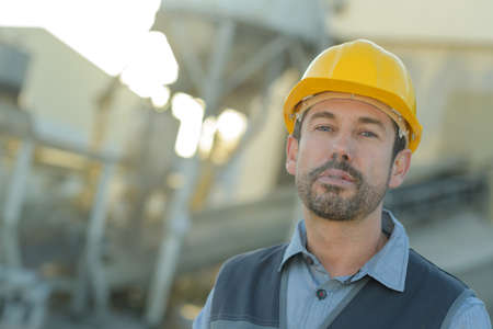 construction worker looking into distance Stock Photo