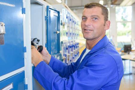 Man at his locker Stock Photo