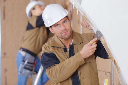 male plasterer renovating wall