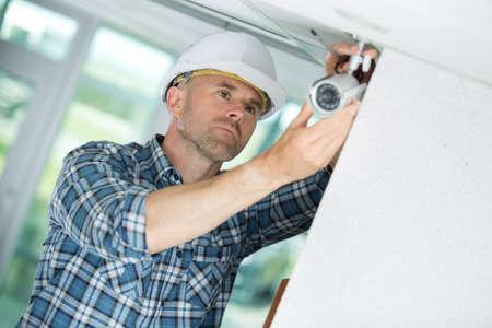 professional cctv technician working Stockfoto