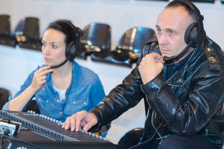 sound engineers working at mixing pane