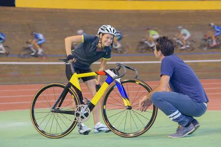 female cyclist training on a velodrome Stock Photo