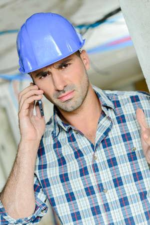 contractor on telephone